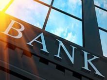 Ngân hàng nào đang dẫn đầu thị trường về thu hút vốn và cho vay ra?