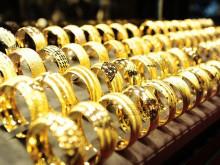 USD, chứng khoán tăng mạnh, kiềm chế đà tăng của giá vàng