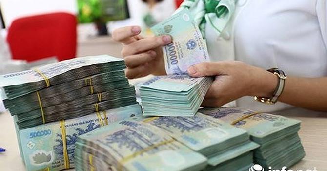 Ngân hàng giảm lợi nhuận, chia sẻ với doanh nghiệp và người dân