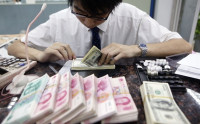 Nhân dân tệ sẽ trở thành đồng tiền thứ 3 toàn cầu vào năm 2030