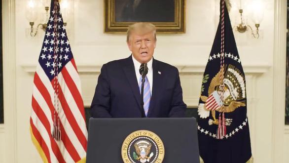 ổng thống Donald Trump ngày 7-1-2021 có bài phát biểu thừa nhận chiến thắng của ông Biden và lên án bạo loạn tại Điện Capitol - Ảnh: REUTERS