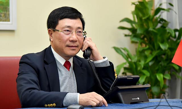 Phó Thủ tướng Phạm Bình Minh điện đàm Cố vấn An ninh quốc gia Hoa Kỳ về việc điều tra chính sách tiền tệ của Việt Nam.