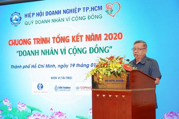 """Ông Huỳnh Văn Minh - Chủ tịch Hội đồng quản lý Quỹ Doanh nhân vì cộng đồng báo cáo kết quả hoạt động của Quỹ trong năm 2020; đồng thời chia sẻ mục đích, ý nghĩa chương trình """"Chăm lo Tết cho người nghèo nhân dịp Xuân Tân Sửu 2021"""""""