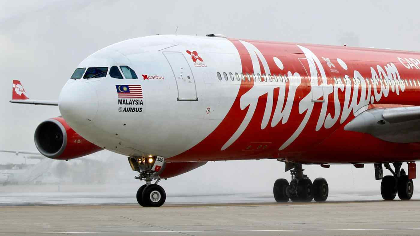AirAsia đã và đang nỗ lực để khắc phục tác động tài chính khắc nghiệt của đại dịch coronavirus bằng cách cắt giảm chi phí, tăng vốn hoạt động và đẩy nhanh việc mở rộng các hoạt động kinh doanh phi hàng không. © Reuters