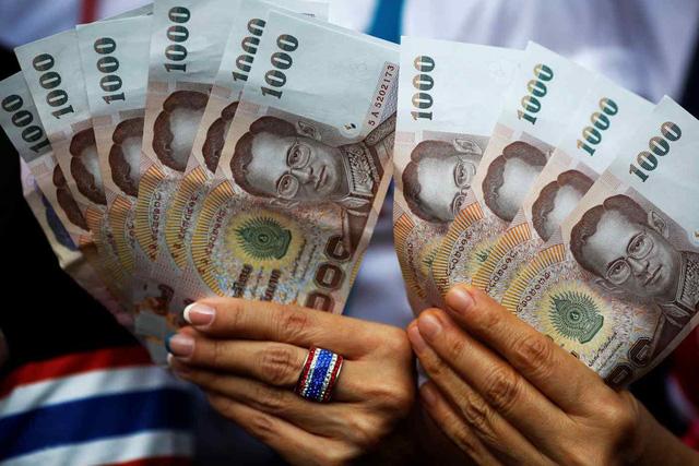 Nền kinh kế bị ảnh hưởng tiêu cực - đồng tiền Thái Lan mất giá nhất khu vực