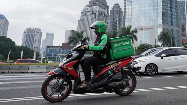 Một người chạy xe Grab giao hàng ở Jakarta: Nhà phát triển