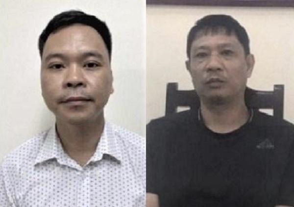Bị can Võ Việt Hùng (áo trắng) và bị can Bùi Quốc Việt (áo đen ) bị khởi tố, bắt tạm giam bổ sung vào ngày 09/7/2020. (Ảnh: Cơ quan Công an cung cấp/TTXVN phát)