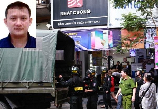 Cơ quan Cảnh sát điều tra Bộ Công an thực hiện khám xét tại một cửa hàng của Cty Nhật Cường. Bùi Quang Huy (ảnh nhỏ góc trên trái) đang bị truy nã quốc tế