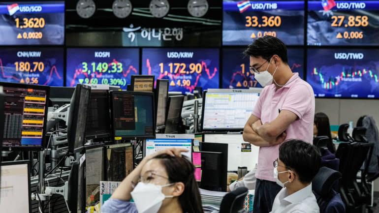 Sự rút lui của các nhà đầu tư khỏi Đông Nam Á đang diễn ra trên thị trường tiền tệ cũng như chứng khoán © AP