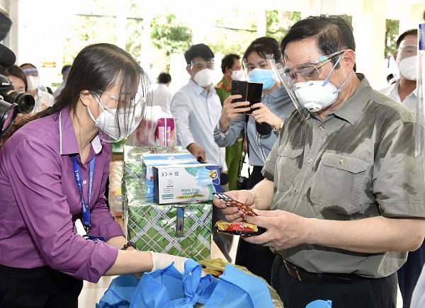 Chùm ảnh: Thủ tướng Phạm Minh Chính kiểm tra công tác chống dịch tại TP. Hồ Chí Minh