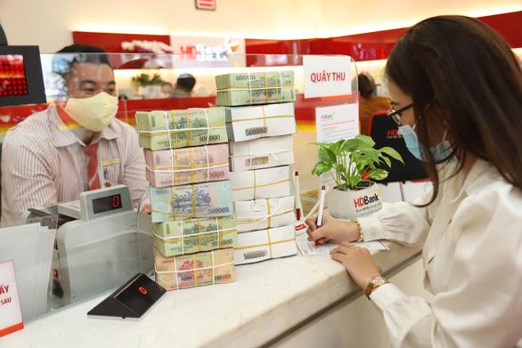 Ngân hàng Nhàn nước cho phép khách hàng vùng phong tỏa được tạm hoãn trả nợ đến ngày 7-9