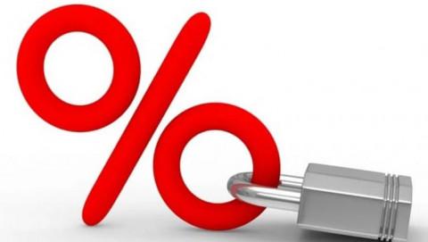 Thách thức giảm lãi suất cho vay và nợ xấu